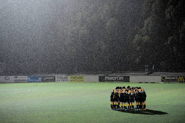 even-when-the-rain-falls-sports-teams-gather-and-play-across-australia-despite-the-weather-photo-by-john-appleyardaustralian-life-prize-2015-900x599